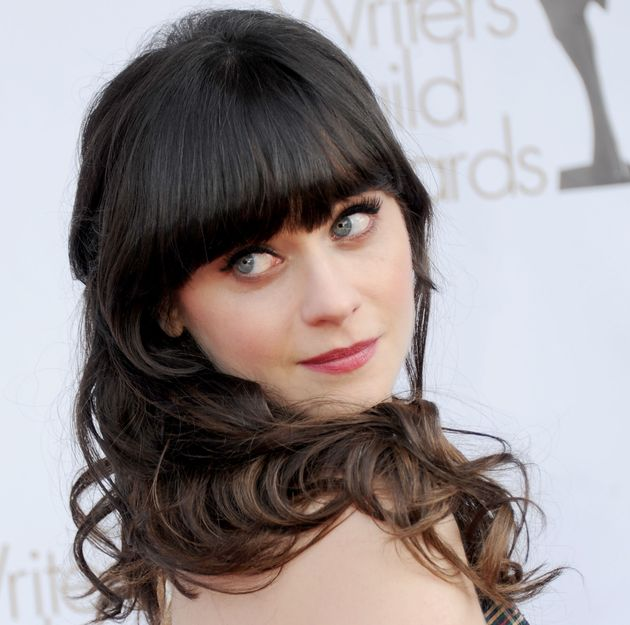 Zooey Deschanel embodies the manic pixie girl persona to a