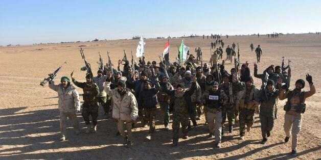 Members of the Hashed al-Shaabi (Popular Mobilisation) paramilitaries, celebrate after the Iraqi Prime...