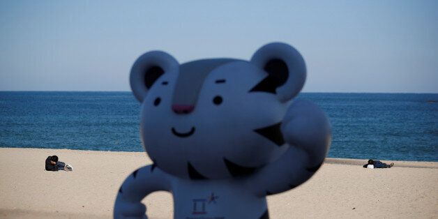 The 2018 PyeongChang Winter Olympics mascot Soohorang is seen as workers lie on the Gyeongpodae beach...