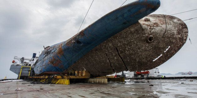 The sunken ferry Sewol on a semi-submersible transport vessel is seen during the salvage operation in...