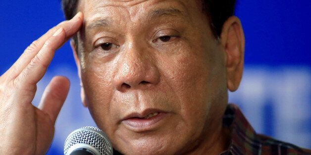 Philippines' President Rodrigo Duterte answer questions during a press briefing after awarding wounded...