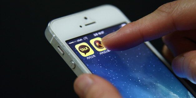 The app icon for KakaoTalk, a messaging app developed by Kakao Corp., left, is displayed on an Apple...