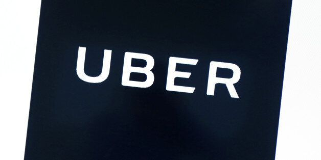 Uber's logo is pictured at its office in Tokyo, Japan, November 27, 2017. REUTERS/Kim