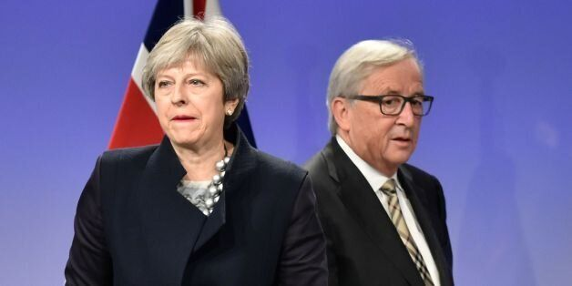 British Prime Minister Theresa May (L) and European Commission chief Jean-Claude Juncker give a press...