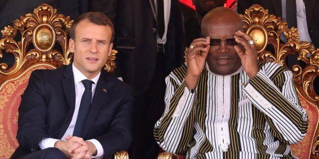 French president Emmanuel Macron (L) speaks with Burkina Faso's President Roch Marc Christian Kabore...