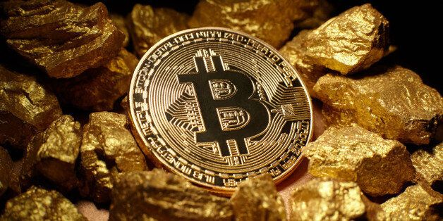 Berlin, Germany - July16, 2017: Golden Bitcoin Coin and mound of gold. Bitcoin cryptocurrency. Business
