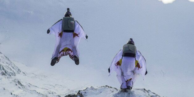 LAUTERBACH, SWITZERLAND - OCTOBER 13: In this handout image provided by Red Bull, wingsuit flyers Fred...