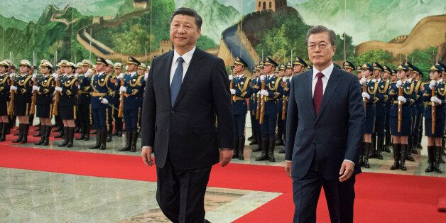 BEIJING, CHINA - DECEMBER 14: South Korean President Moon Jae-In (R) and Chinese President Xi Jinping...