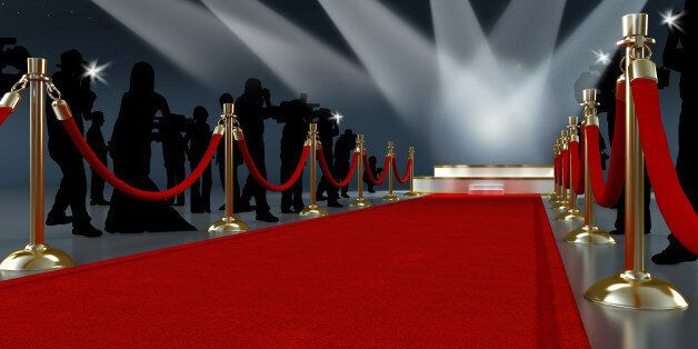 Movie night concept with spotlights, red carpet, gold barriers, velvet ropes and paparazzis... High resolution...