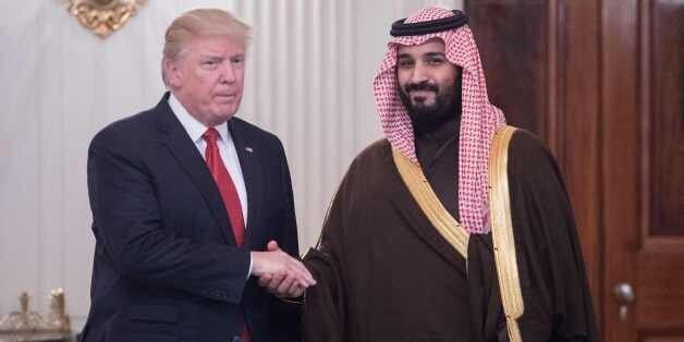 US President Donald Trump and Saudi Deputy Crown Prince and Defense Minister Mohammed bin Salman shake...