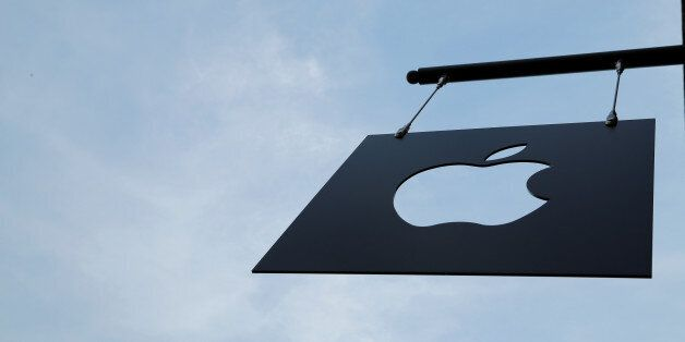 The Apple logo hangs from the front of the new Apple Store Williamsburg in Brooklyn, New York, U.S.,...