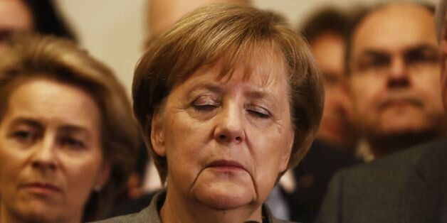 German Chancellor and leader of the Christian Democratic Union (CDU) party, Angela Merkel (C), closes...
