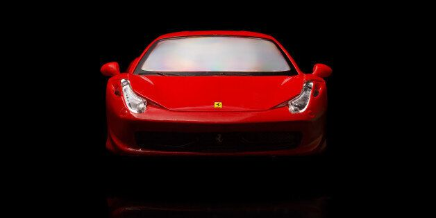 Krivoy Rog, Ukraine - August 22, 2014: Toy ferrari 458 Italia on black backgrond. The photo is made in...