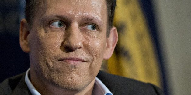 Peter Thiel, co-founder of PayPal Inc., pauses while listening to a question during a news conference...