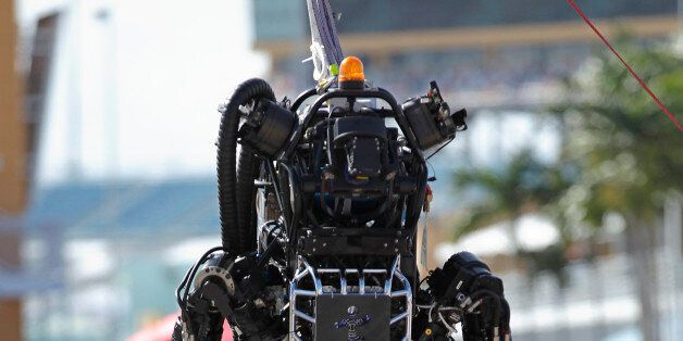 Boston Dynamics' Atlas, a high-mobility, humanoid robot designed to negotiate rough terrain, takes on...