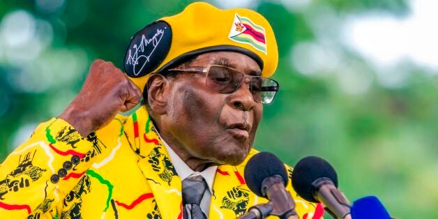 Zimbabwe's President Robert Mugabe addresses party members and supporters gathered at his party headquarters...