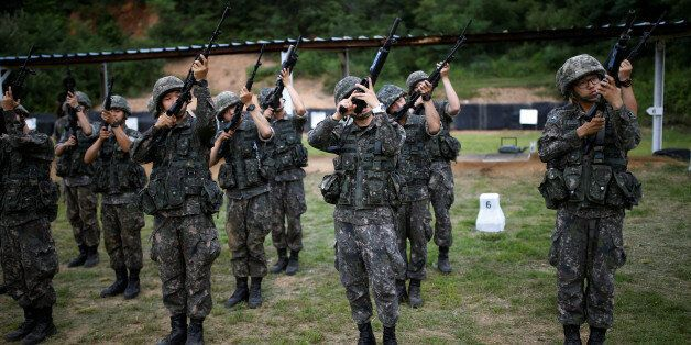 South Korean soldiers take part in a firearms training at a military base near the demilitarized zone...