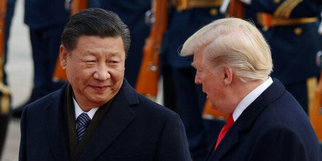 U.S. President Donald Trump takes part in a welcoming ceremony with China's President Xi Jinping at the...