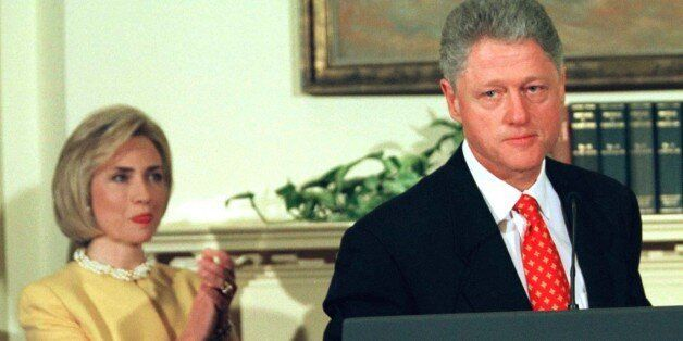 President Clinton says he is going back to work while first lady Hillary Rodham Clinton applauds during...