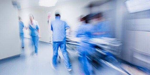 Doctors and nurses pulling hospital