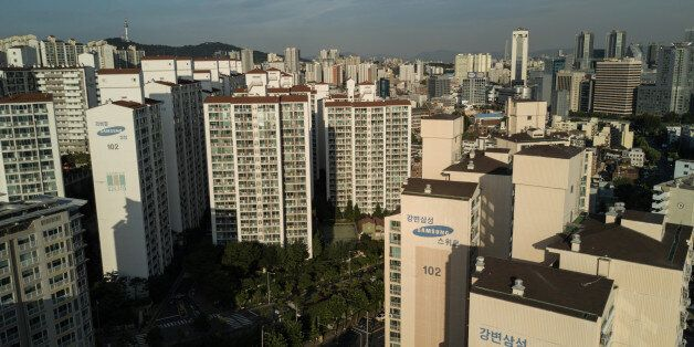 Samsung apartment buildings are shown before the city skyline of Seoul on August 25, 2017.Heir to the...