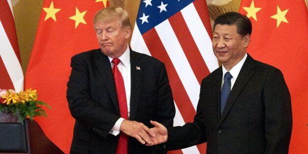 BEIJING, CHINA - NOVEMBER 9, 2017: US President Donald Trump (L) and China's President Xi Jinping shake...