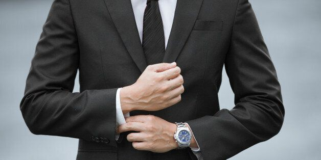 Close up of businessman wearing suit and