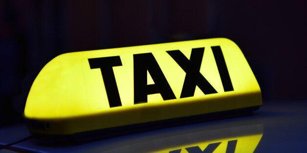Illuminated yellow Taxi signIlluminated yellow Taxi
