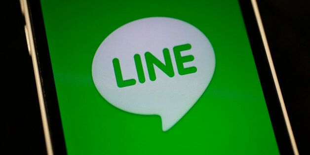 The logo of free messaging app Line is pictured on a smartphone in this photo illustration taken in Tokyo...