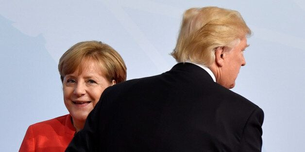 German Chancellor Angela Merkel greets U.S. President Donald Trump at the beginning of the G20 summit...