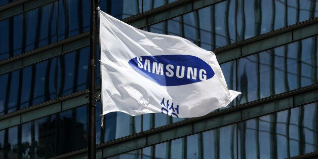The Samsung Electronics Co. corporate flag flies outside the company's Seocho office building in Seoul,...