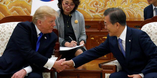 U.S. President Donald Trump and South Korea's President Moon Jae-in shake hands at South Korea's...