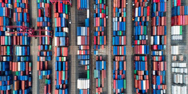 Shipping containers sit stacked in this aerial photograph taken above the Busan Port Terminal (BPT) in...