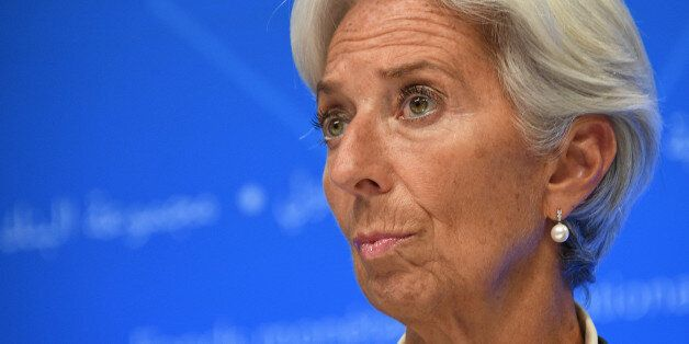 IMF Managing director Christine Lagarde looks on as she attends a press conference at the World Bank...