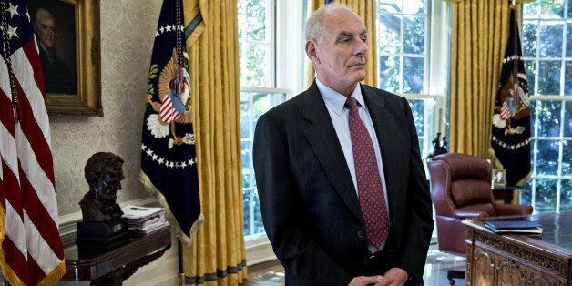 John Kelly, White House chief of staff, stands in the Oval Office of the White House during a meeting...