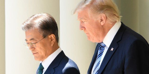 South Korean President Moon Jae-in (L) and US President Donald Trump arrive for a joint press conference...
