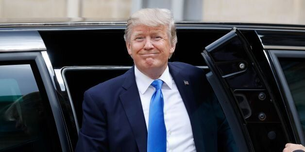 US President Donald Trump gets out of the car as he arrives at the Elysee Palace on July 13, 2017 in...