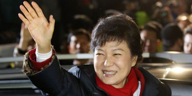 South Korea's president-elect Park Geun-Hye from the ruling New Frontier Party, waves to supporters outside...