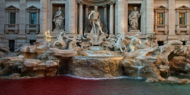 ROME, ITALY - OCTOBER 26: A blood-red dye was poured by public-artist Graziano Cecchini into the Trevi's...