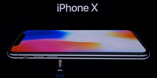 CUPERTINO, CA - SEPTEMBER 12: Apple CEO Tim Cook introduces iPhone X during the Apple launch event on...
