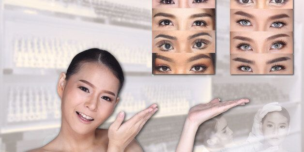 Young White Asian woman show empty copy space on the hand palm with clinic background, Concept Beauty...