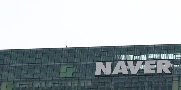 Naver Corp. signage is displayed atop the company's headquarters in Seongnam, South Korea, on Tuesday,...