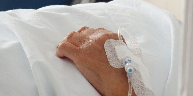 Patient in hospital bed with intravenous