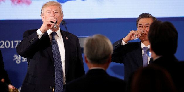 U.S. President Donald Trump and South Korea's President Moon Jae-in share a toast during a state dinner...
