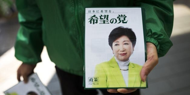 In this picture taken on October 18, 2017, a man distributes electoral leaflets of Tokyo Governor and...