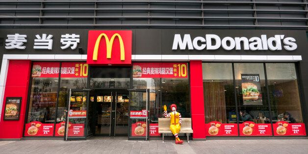 JILIN, JILIN PROVINCE, CHINA - 2016/10/13: A Ronald McDonald statue waves hand to customers outside a...