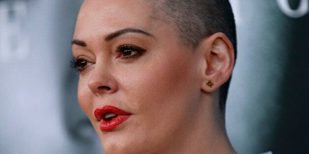 Actress Rose McGowan poses at the premiere for the television
