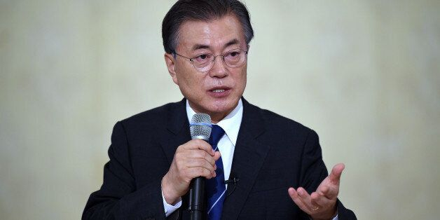 South Korean President Moon Jae-In speaks during a press conference marking his first 100 days in office...