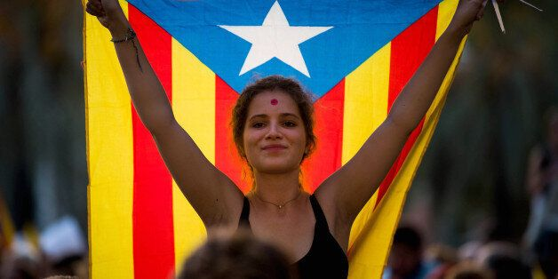BARCELONA, SPAIN - SEPTEMBER 21: A demonstrator holding a Catalan Pro-Independence flag 'Estelada' demonstrates...