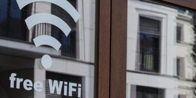 free wifi symbol - wireless internet icon on shop